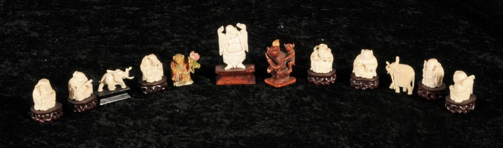 12 CHINESE CARVED PCS.   11  IVORY FIGURES AND AN ANIMA
