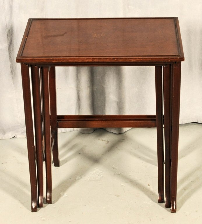 """NEST OF THREE  MAHOGANY TABLES. SOME SCRATCHES. 21"""" H X"""