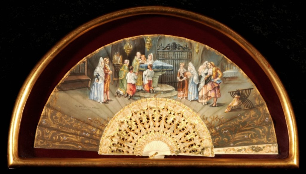 ANTIQUE  HAND PAINTED FAN.  CARVED & GILT IVORY STICKS.