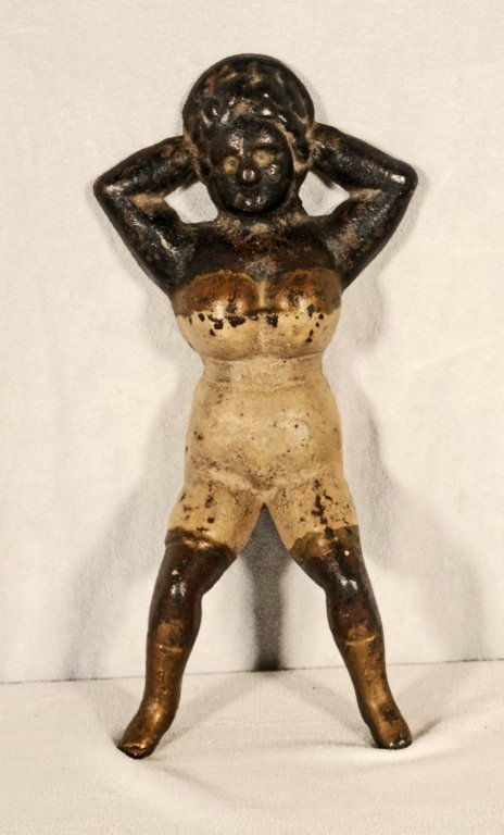 IRON BOOT JACK. FIGURE OF A RECLINING LADY WITH A PAINT