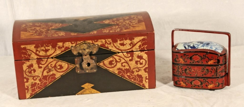 2 CHINESE BOXES. ONE HAS BLACK & RED DECORATION AND THE