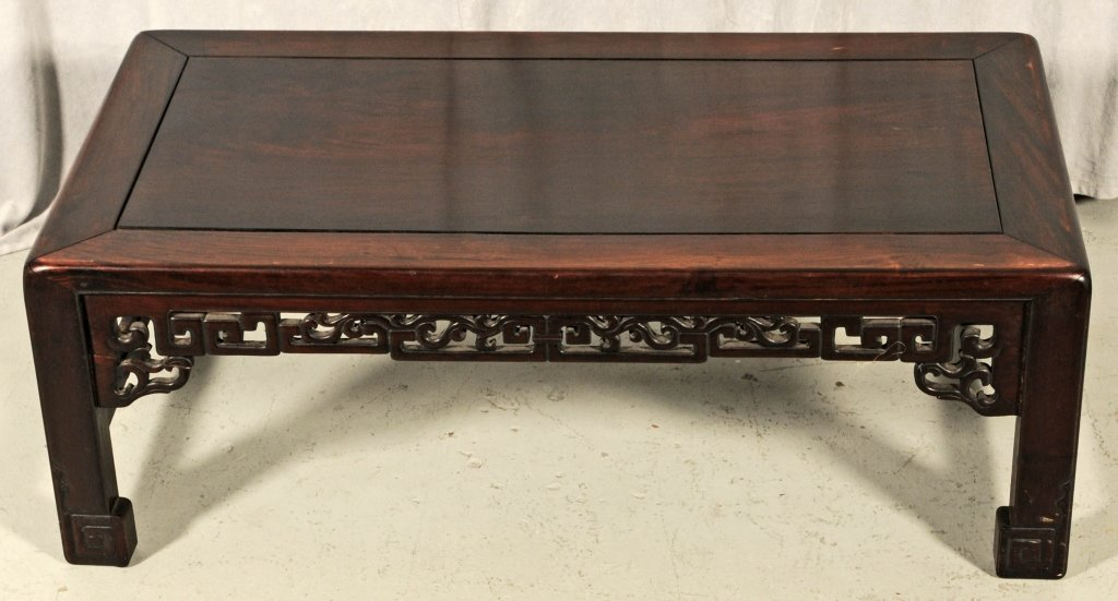 CHINESE LOW MAHOGANY TABLE. OPEN WORK FRIEZE IS MISSING