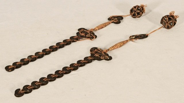2 ORIENTAL COIN DAGGERS.  HANGING COIN BALLS ON THE