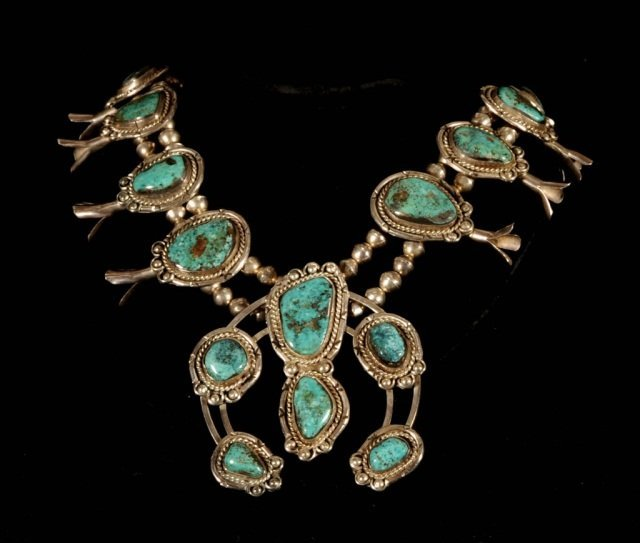 STERLING SILVER  AND TURQUOISE SQUASH BLOSSOM NECKLACE.