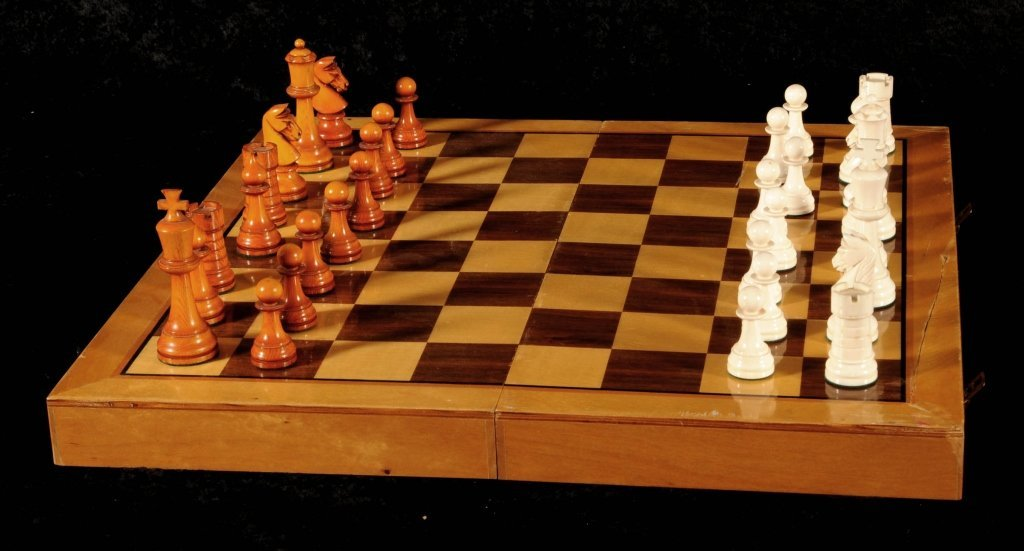 CARVED IVORY CHESS SET AND FITTED CASE.  CASE OPENS
