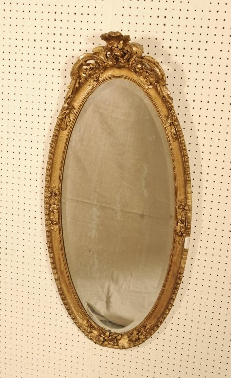 OVAL  GILT  WALL MIRROR.  BEVELLED GLASS.  FLORAL AND