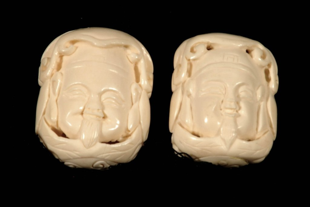 2 IVORY BUDDHA  PENDANTS ON CLOTH CHAINS. DOUBLE FACED