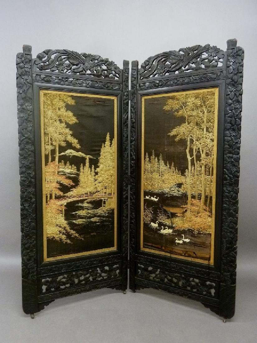Circa 1900 Heavily Carved Asian Screen with Silk