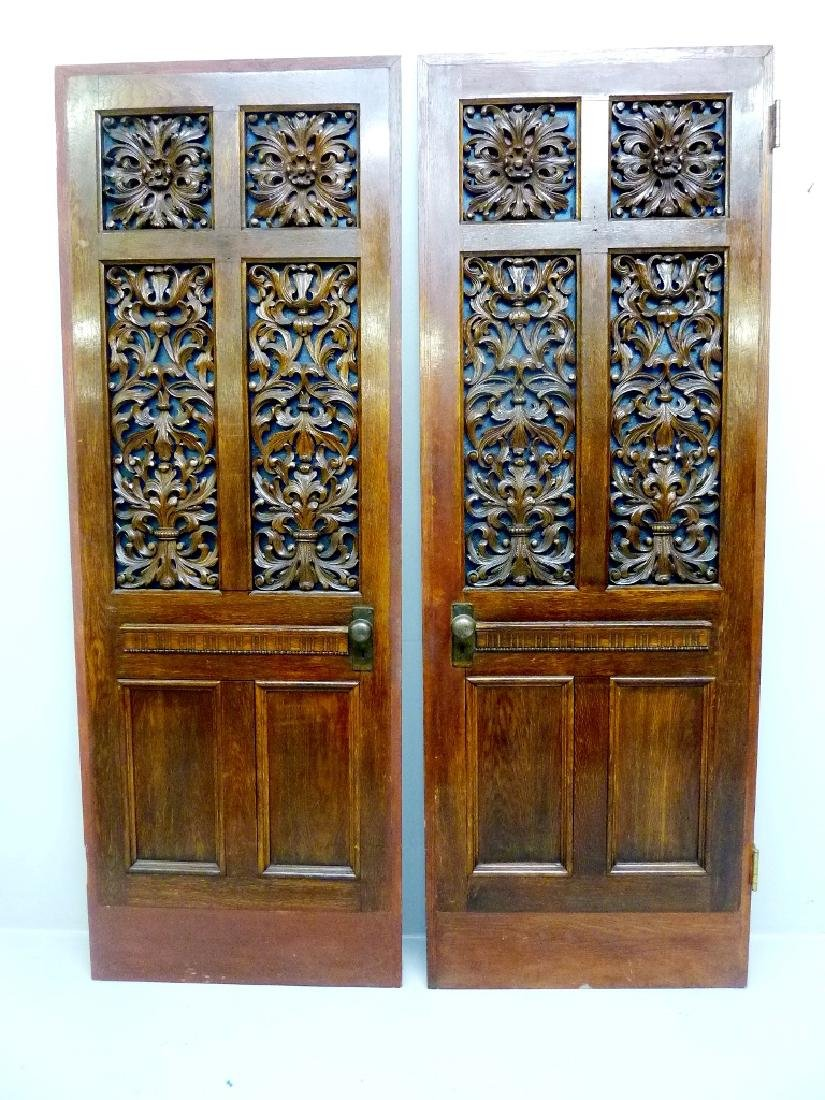 Circa 1900 Solid Oak Carved Doors with Blue & Red Glass