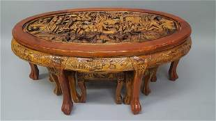 Heavily Carved Asian Scenic Tea Table with 6 Smaller