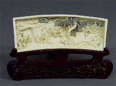 89: A CHINESE CARVED IVORY PLAQUE with VILLAGE SCENE wi