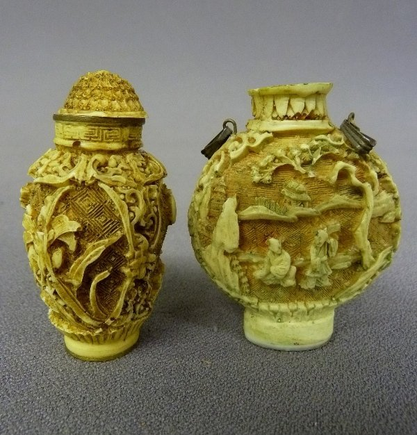 Two White Cinnabar Chinese Snuff Bottles - the one on t