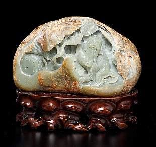 Chinese Carved Jade Boulder of  a dark celadon color