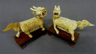 Pair of Carved Chinese Bone and Bead Inlaid Chimera