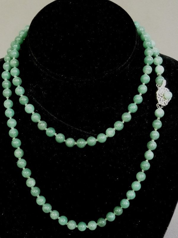 "33"" Green Jade Strand with 7.5mm beads. Clasp marked"