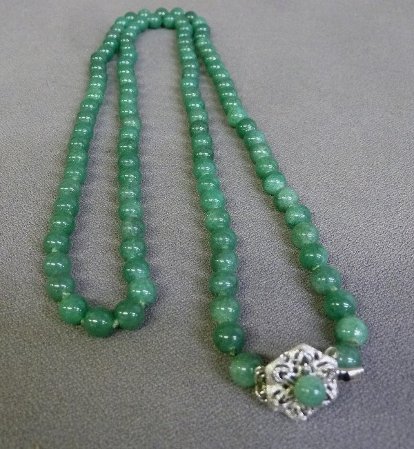 "33"" Green Jade Strand with 7.5mm beads. Clasp marked - 2"