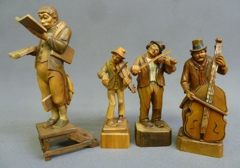 4 Hand Carved Wooden Figures with Musicians and