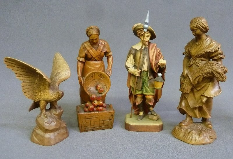 Group of 4 Hand Carved Wooden Figures Depicting