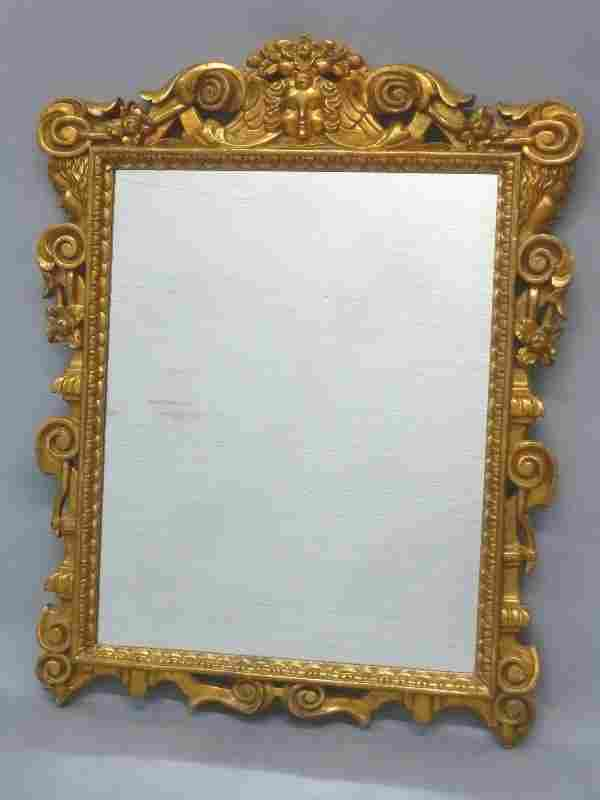 Carved Wood Gold Leaf Unusual Mirror with Child's Face