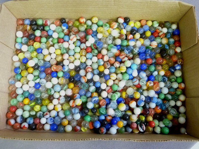 """Group of old marbles in 16"""" x 10"""" box."""