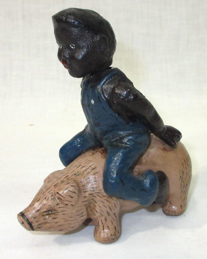 Modern C.I. Boy on a Pig Still Bank