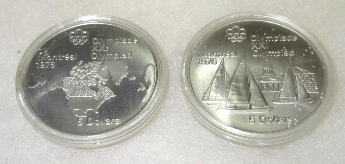 2 XXI Olympiad Silver Medallions