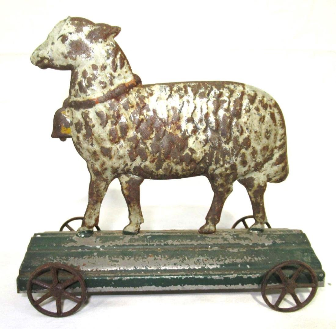 Early Tin Sheep on Platform Toy