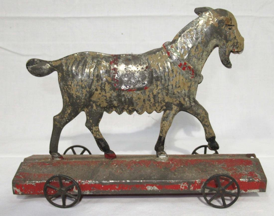 Early Tin Goat on Platform Toy