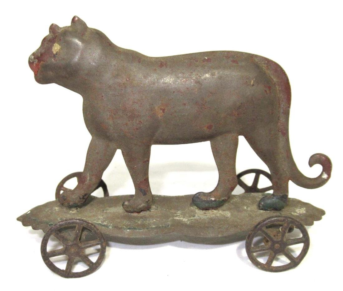Early Tin Tiger on Platform Toy