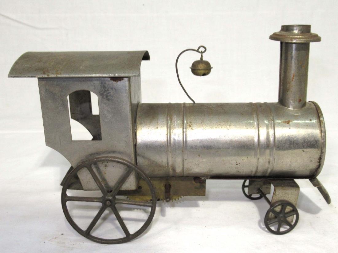Early Tin Key Wind Locomotive Toy