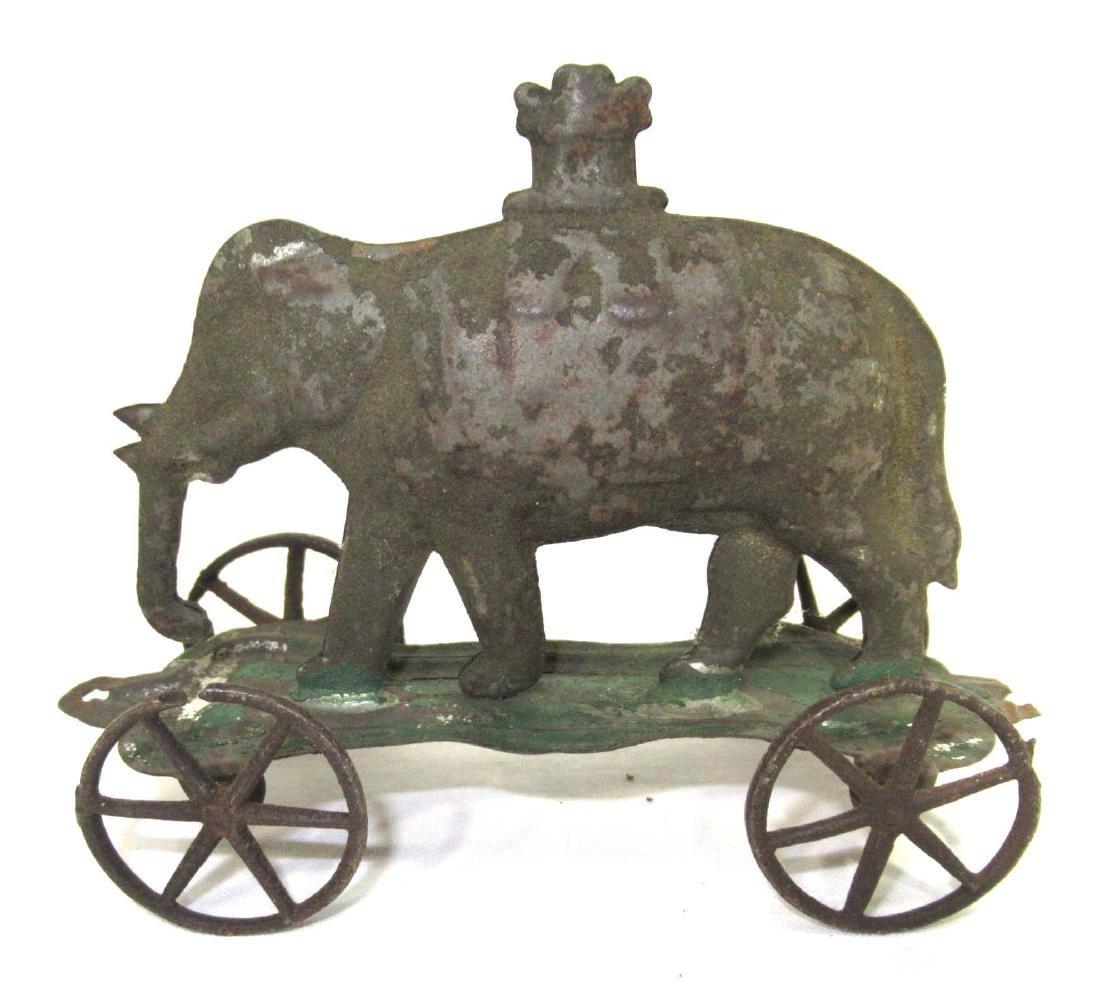 Early Tin Elephant On Platform Toy