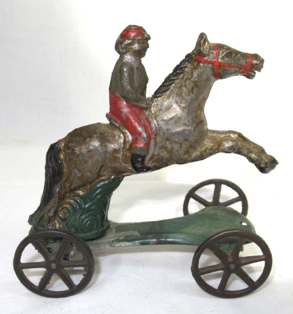 Early Tin Horse & Rider on Platform Toy