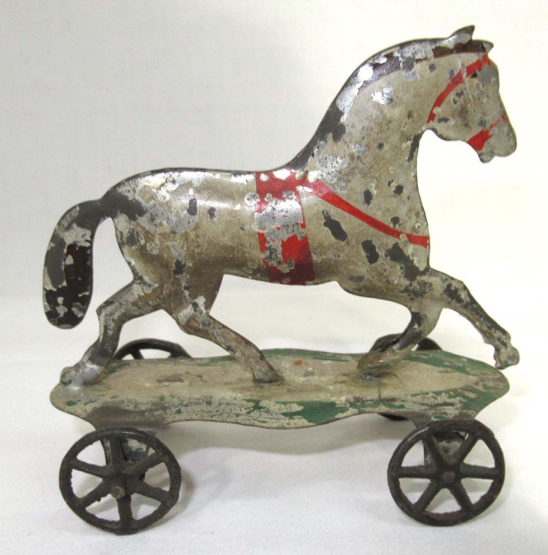 Early Tin Horse On Platform Toy