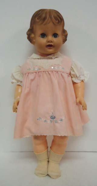 4: Hard Plastic Doll w/ Rubber Head