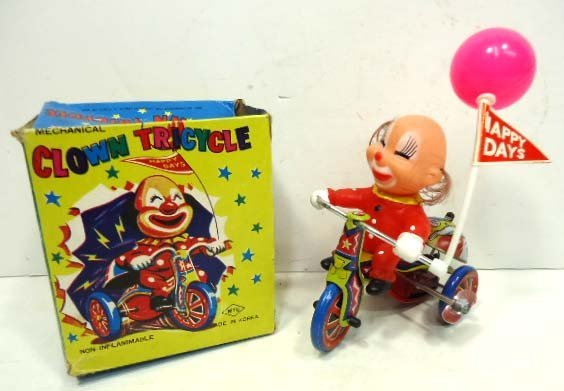 35C: Mechanical Clown Tricycle Toy in Box