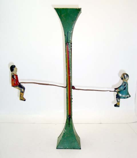 15F: Tin Teeter Totter Toy