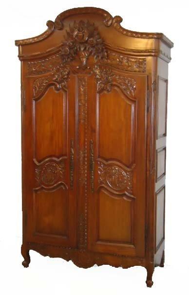 105A: Heavily Carved Mahogany Armoire