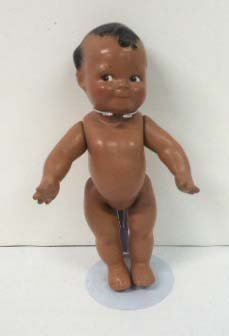 7: Black Compo Scootles Doll