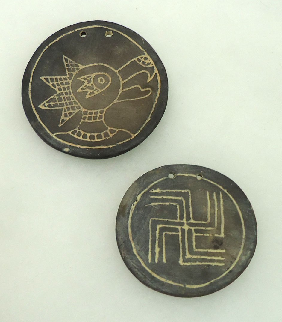 2 Incised Clay Pendants