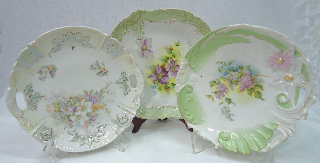 3- H.P. Cake Plates ( 2- R.S. Prussia)