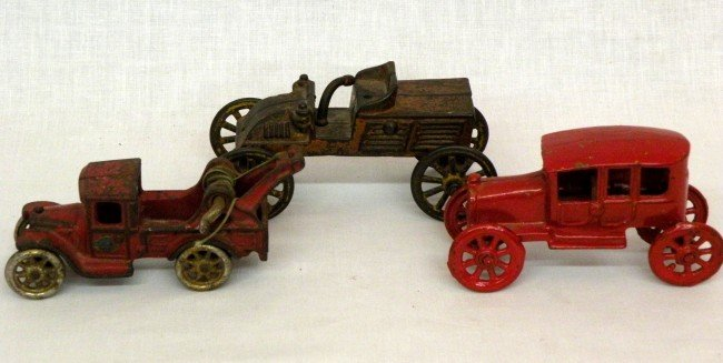 10: 3 cast iron vehicles