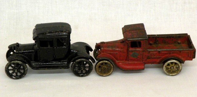 11: 2 cast iron vehicles