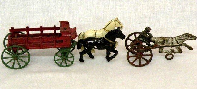 12: 2 cast iron toys