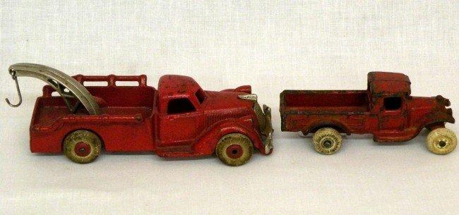 13: 2 cast iron trucks