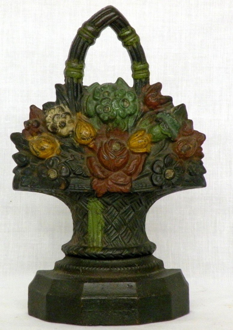 252: Hubley basket of flowers iron doorstop