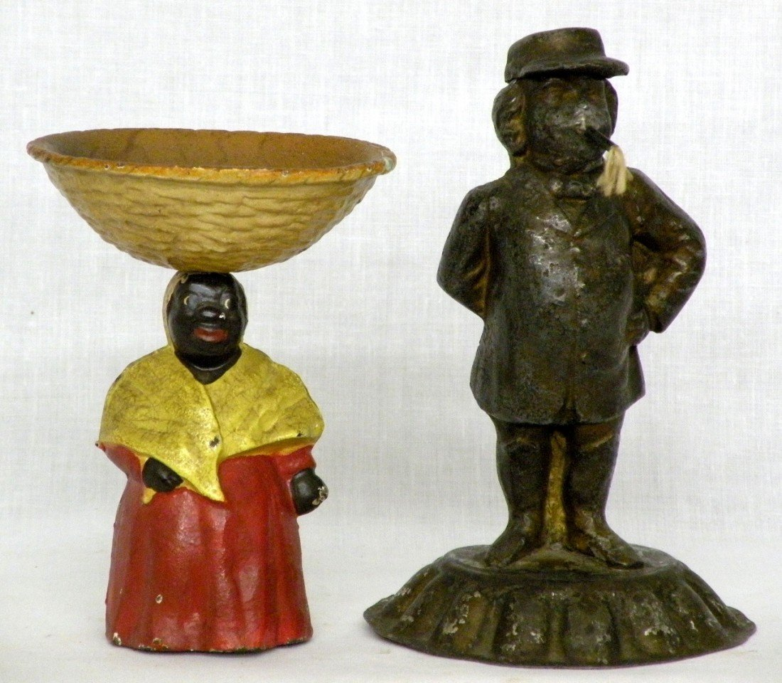 253: 2 cast iron figures
