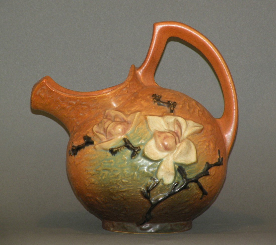 """12: Brown Roseville """"Magnolia"""" water pitcher"""
