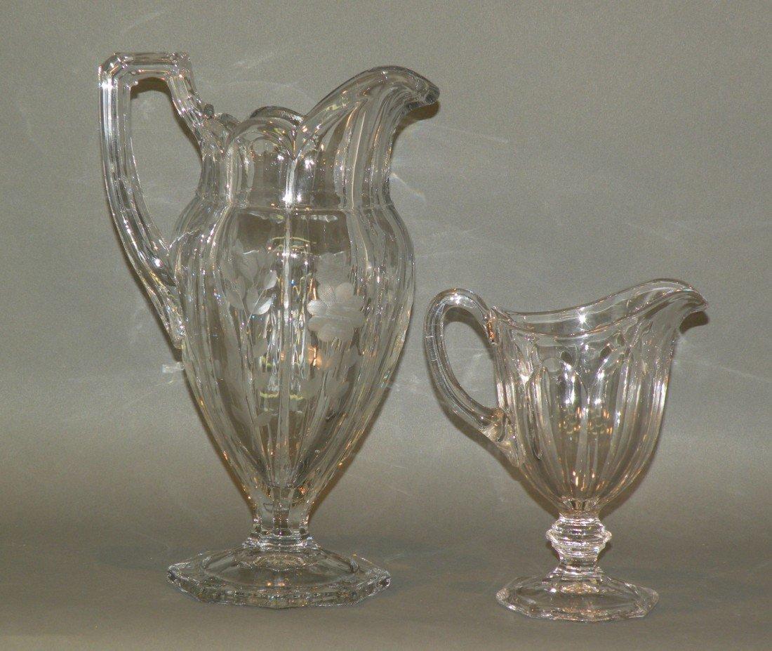 97: 2 Heisey glass pitchers