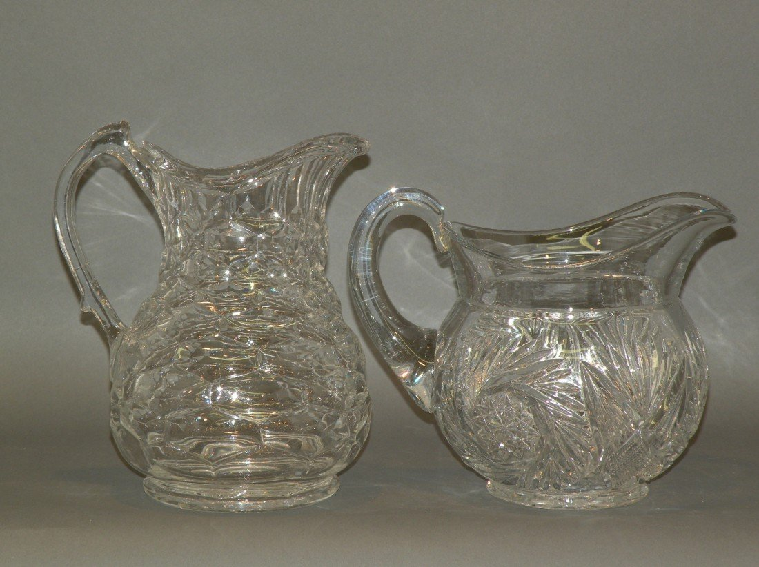 99: 2 glass pitchers