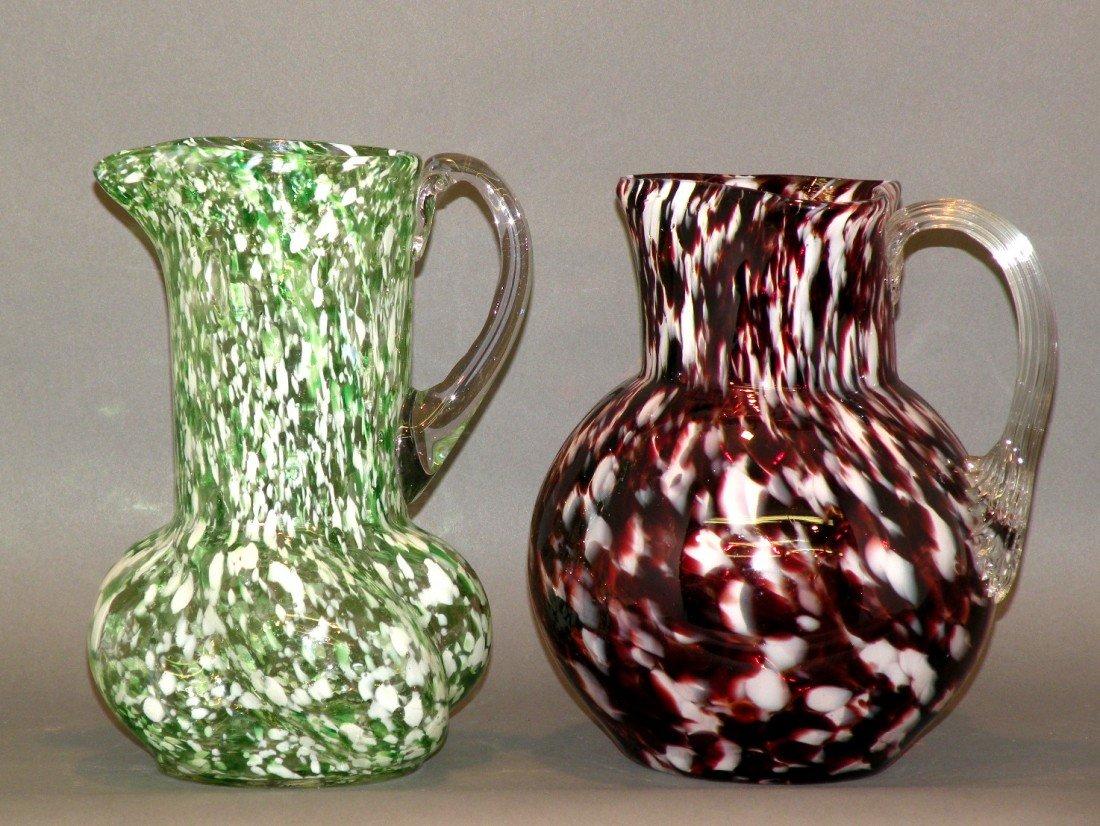 100: 2 art glass pitchers